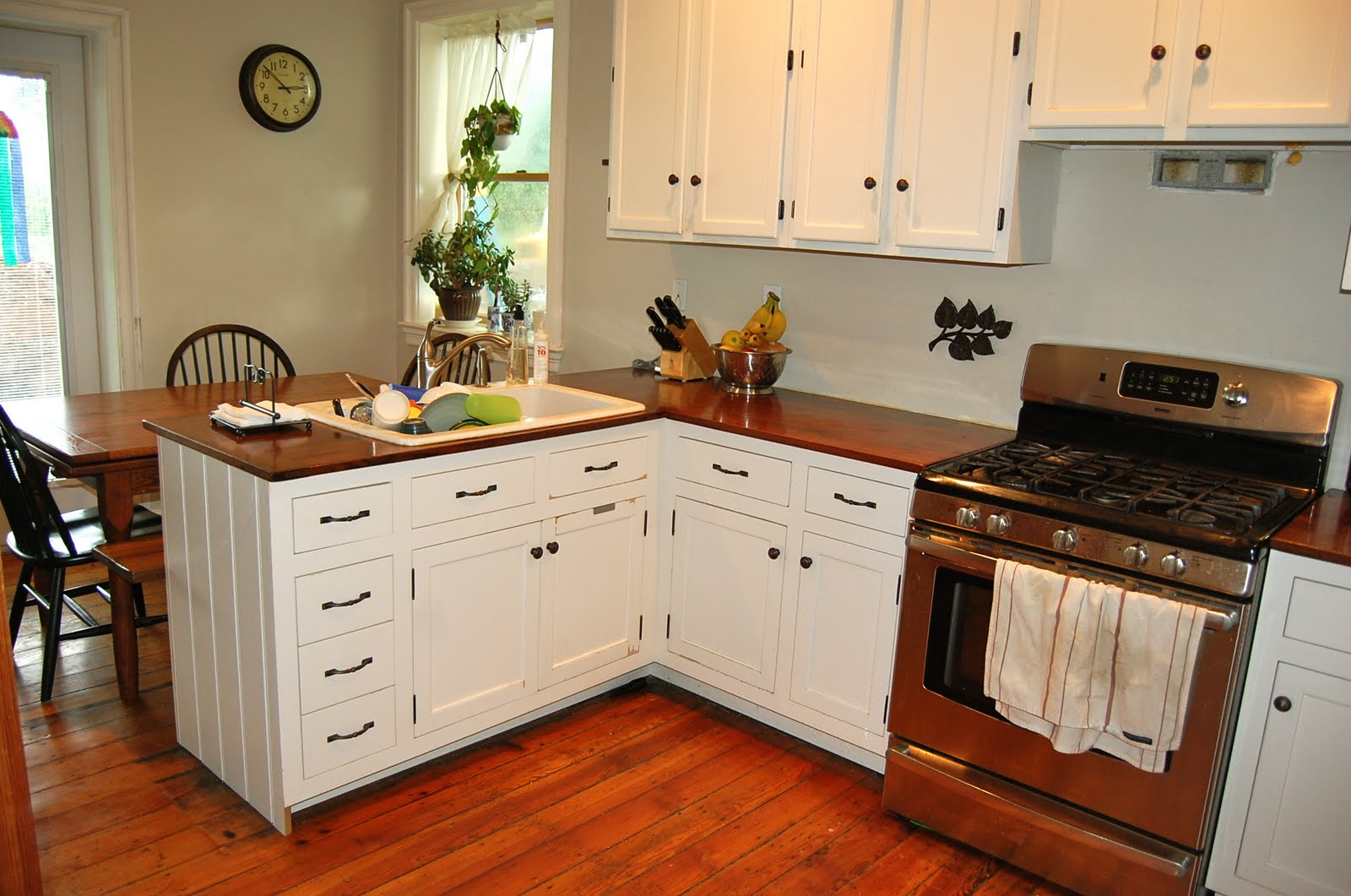 White Kitchen Interior with Wooden Countertop