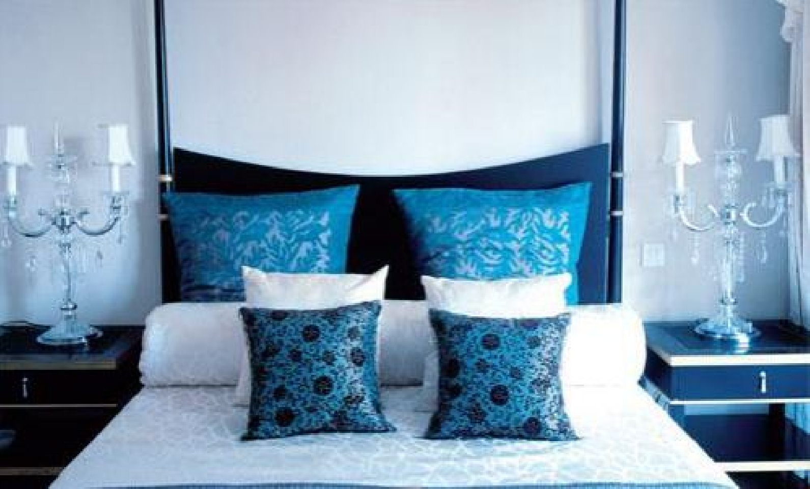 Black and white bedrooms with blue accents