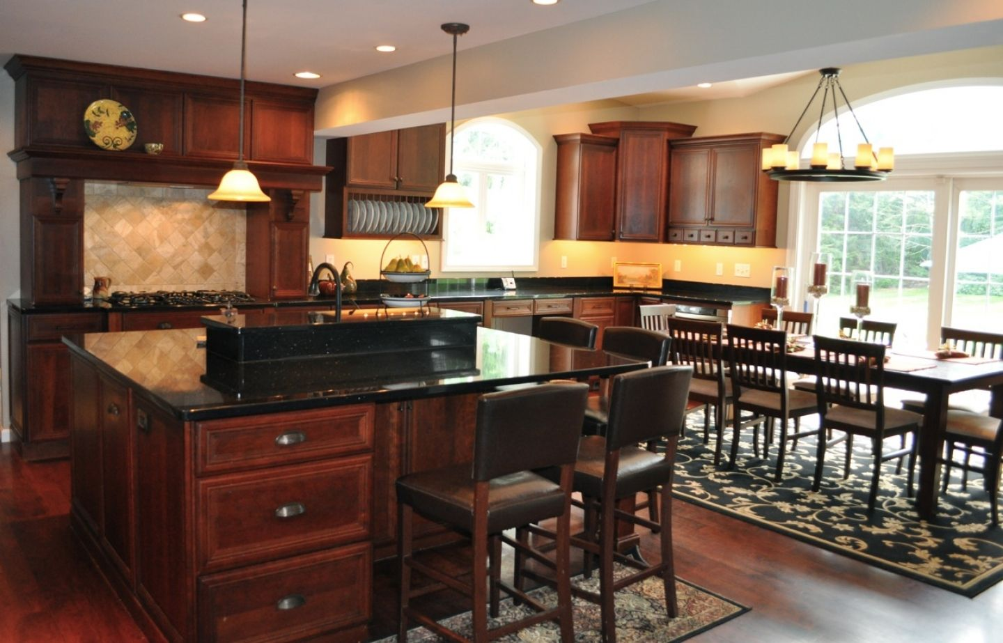 Black kitchen cabinets with granite