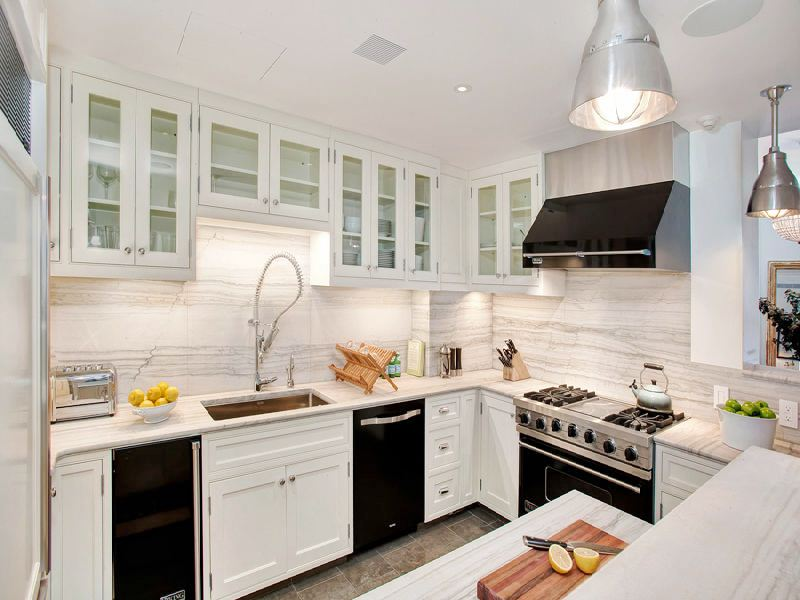 Black kitchen cabinets with white appliances