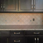 Dark cabinets tile backsplash