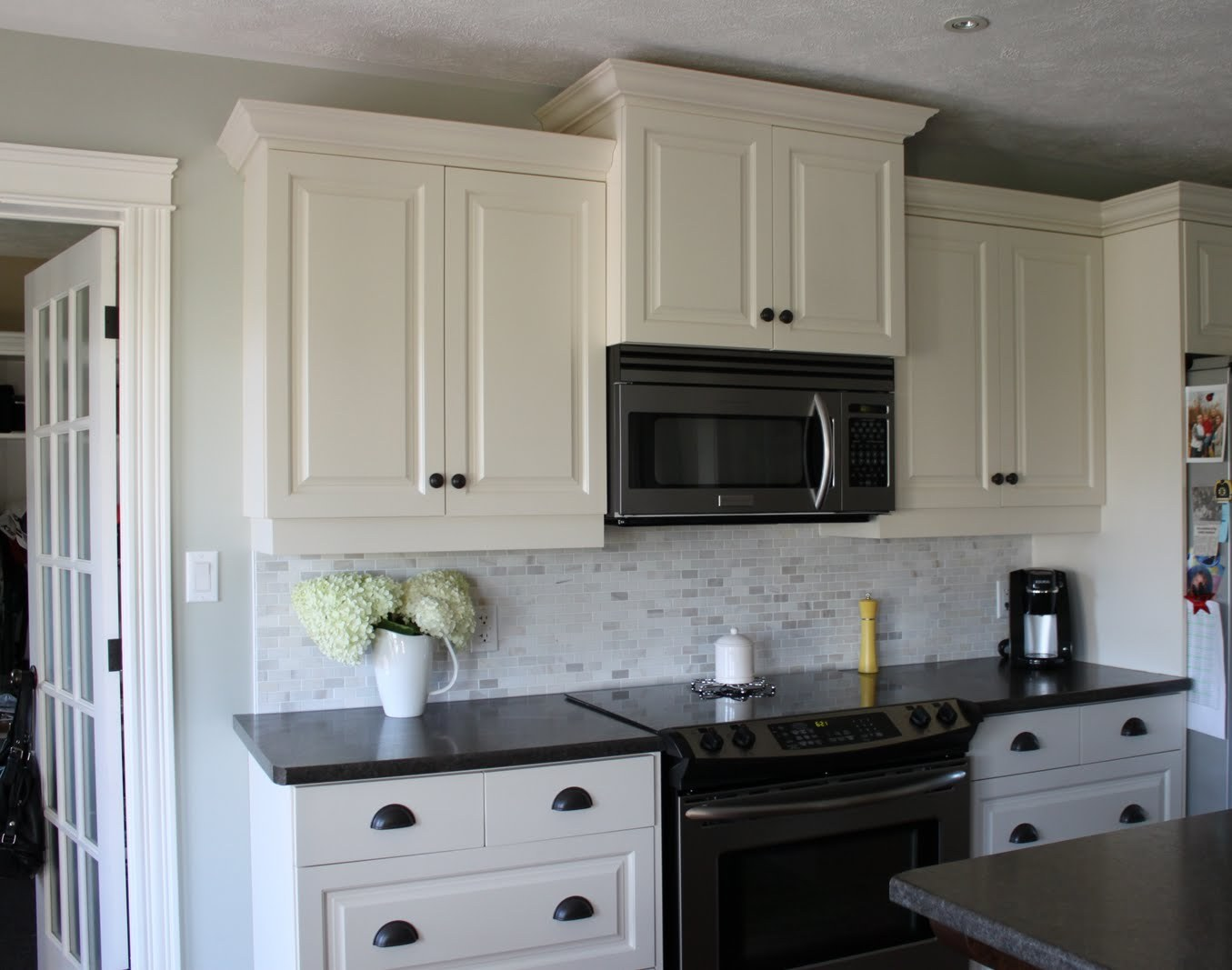 Dark cabinets white backsplash