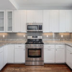 Kitchen white cabinets backsplash