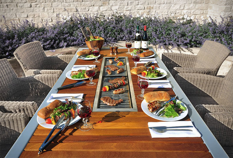 Outdoor dining table with grill