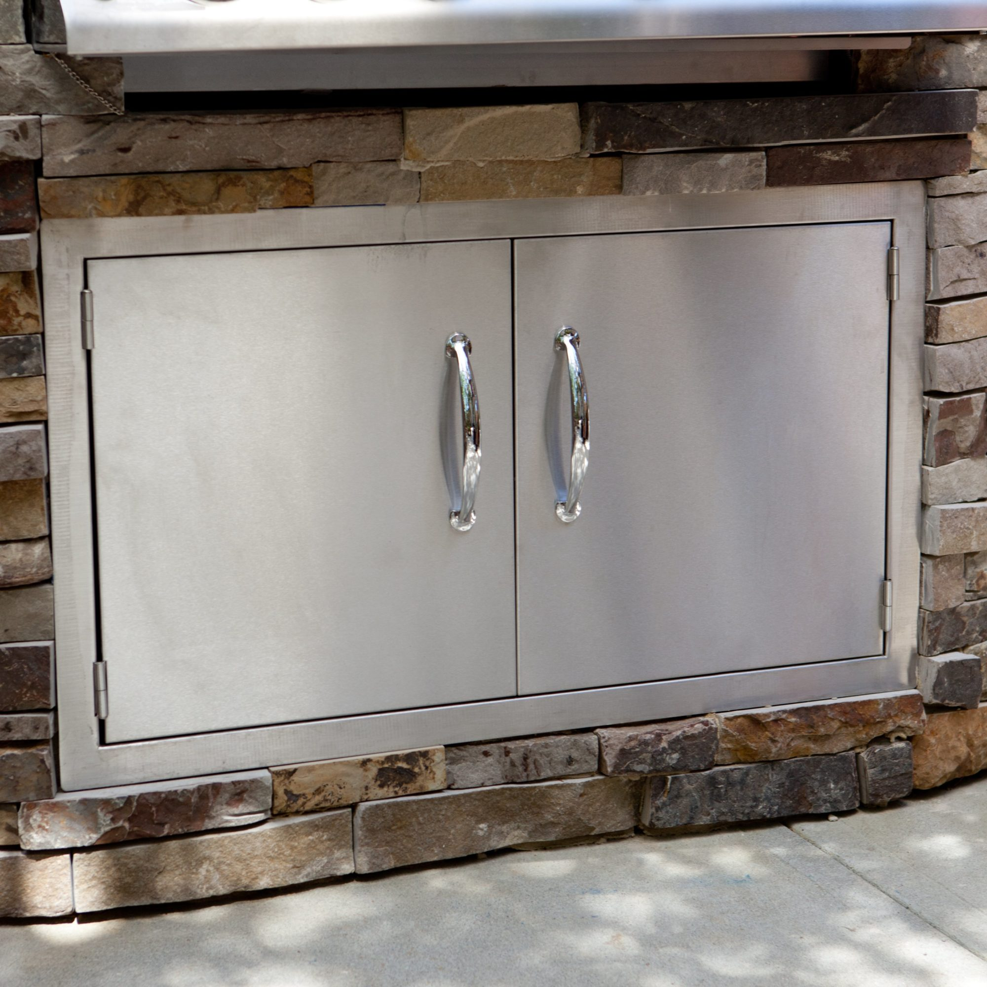 Outdoor kitchen access doors