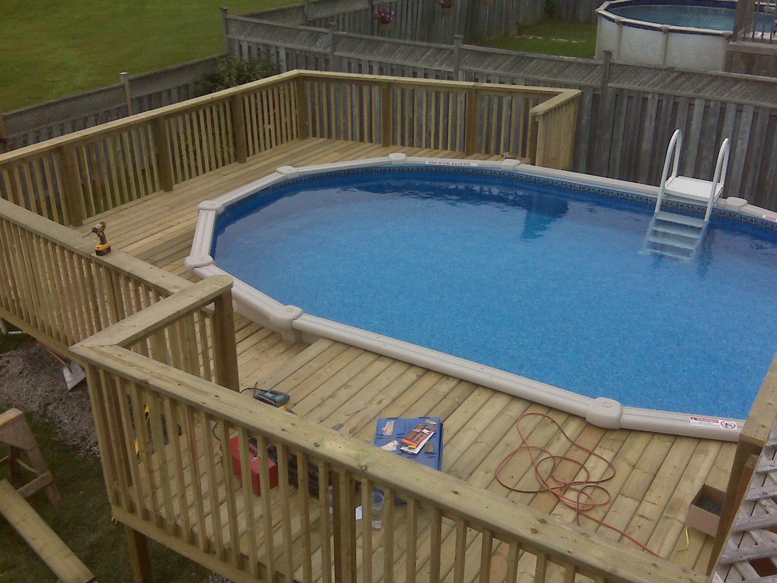 Swimming pool designs with decking