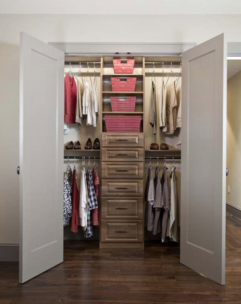 Walk in closet in a small bedroom