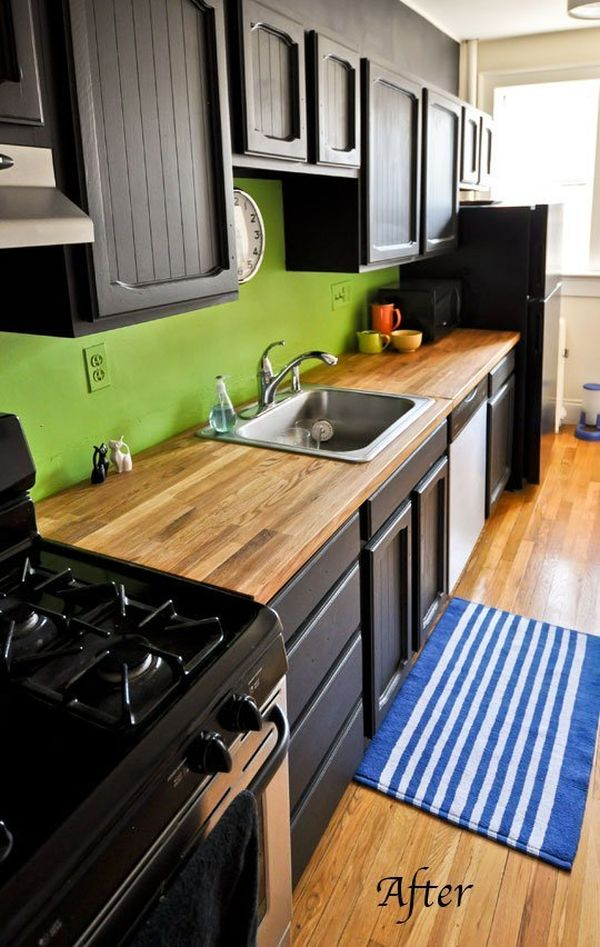 black kitchen cabinets and green walls photo - 2