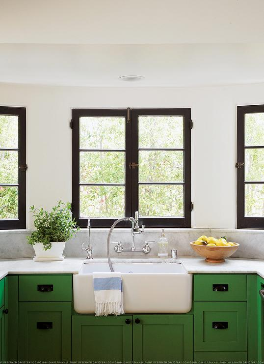 black kitchen cabinets and green walls photo - 3