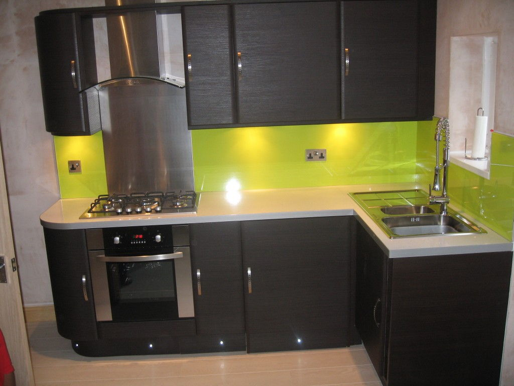 black kitchen cabinets and green walls photo - 9