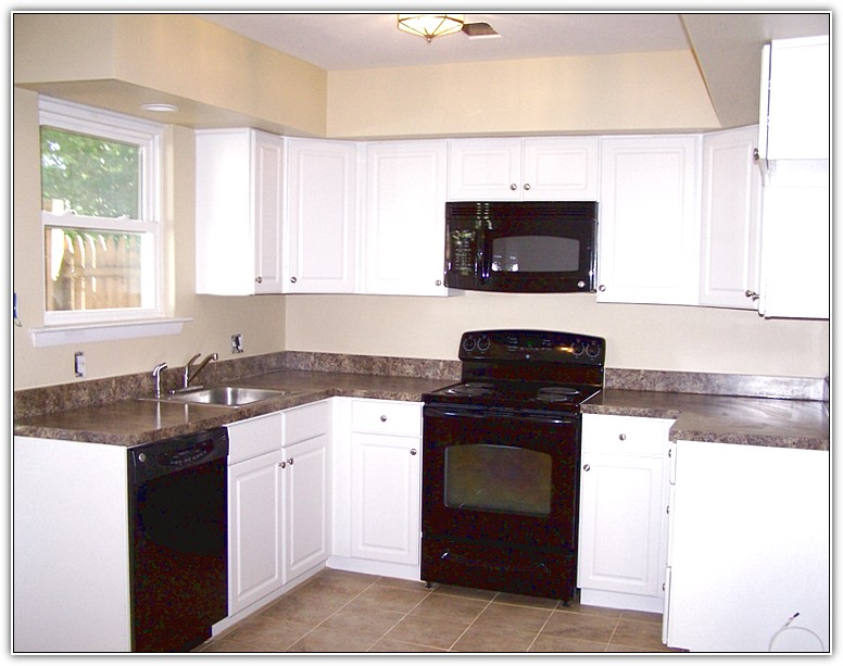 black kitchen cabinets and white appliances photo - 10