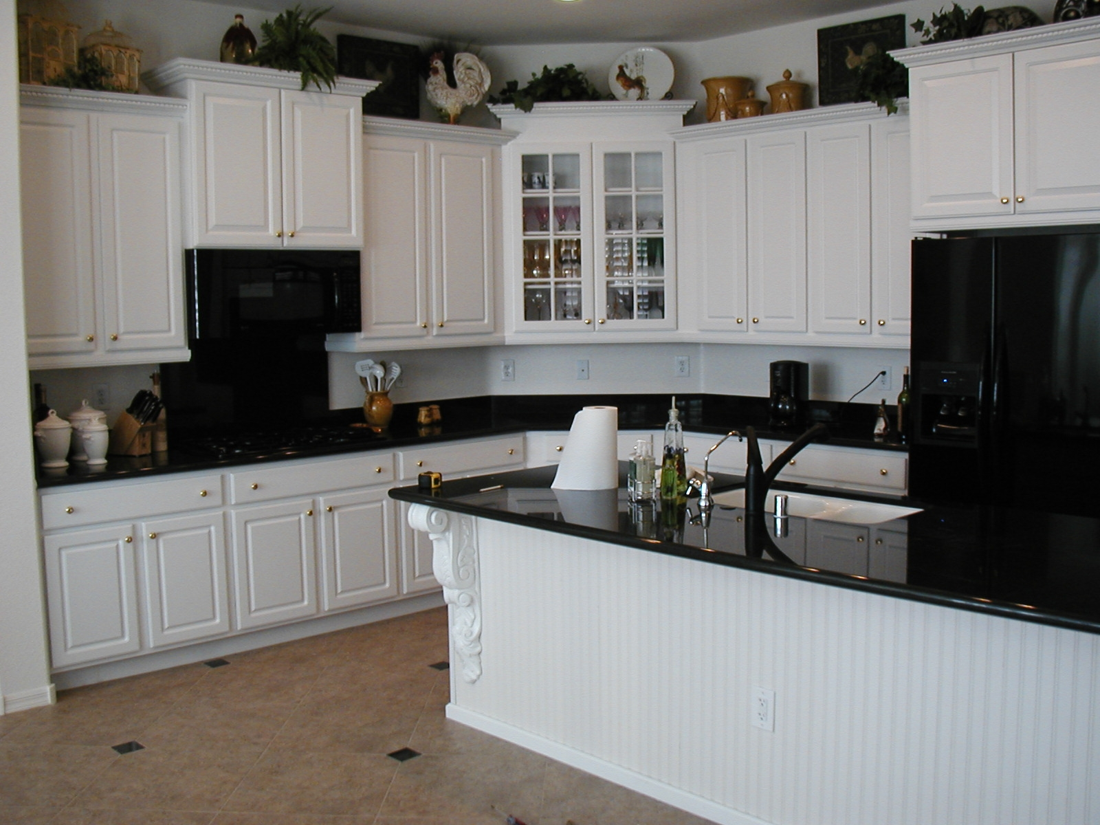black kitchen cabinets and white appliances photo - 2
