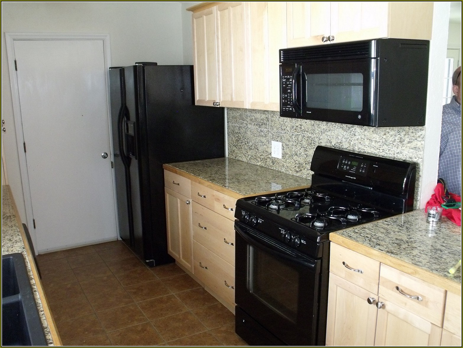 black kitchen cabinets and white appliances photo - 5