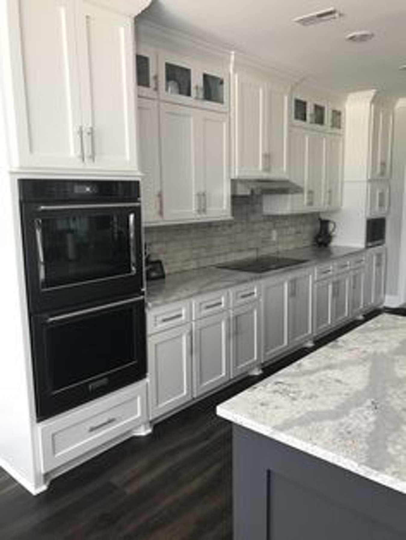 black kitchen cabinets and white appliances photo - 7