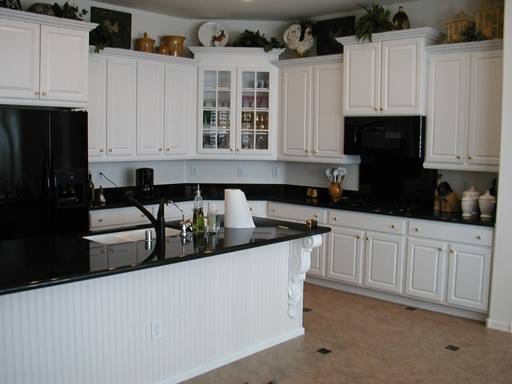 black kitchen cabinets and white appliances photo - 8
