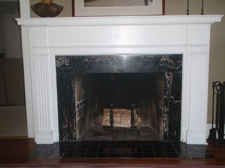 black marble fireplace surround photo - 5