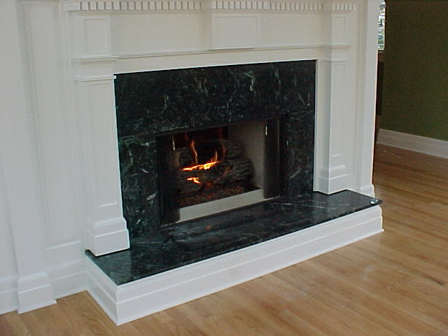 black marble fireplace surround photo - 7
