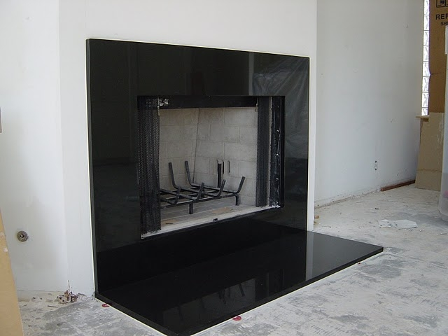black marble fireplace surround photo - 8