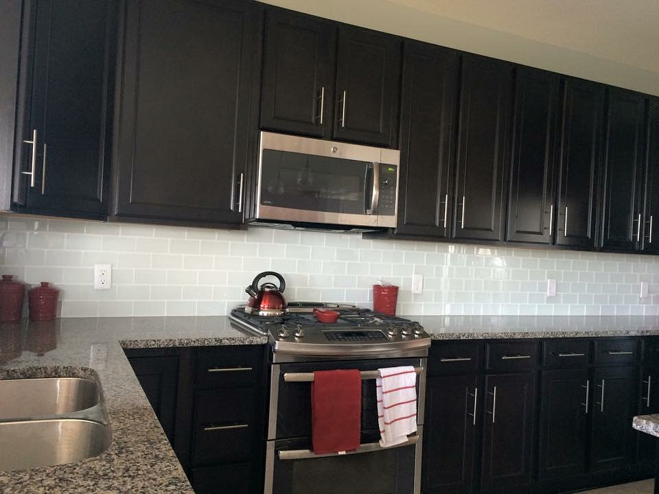 dark cabinets white backsplash photo - 2