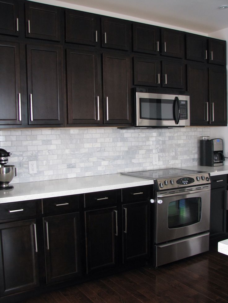dark cabinets white backsplash photo - 3