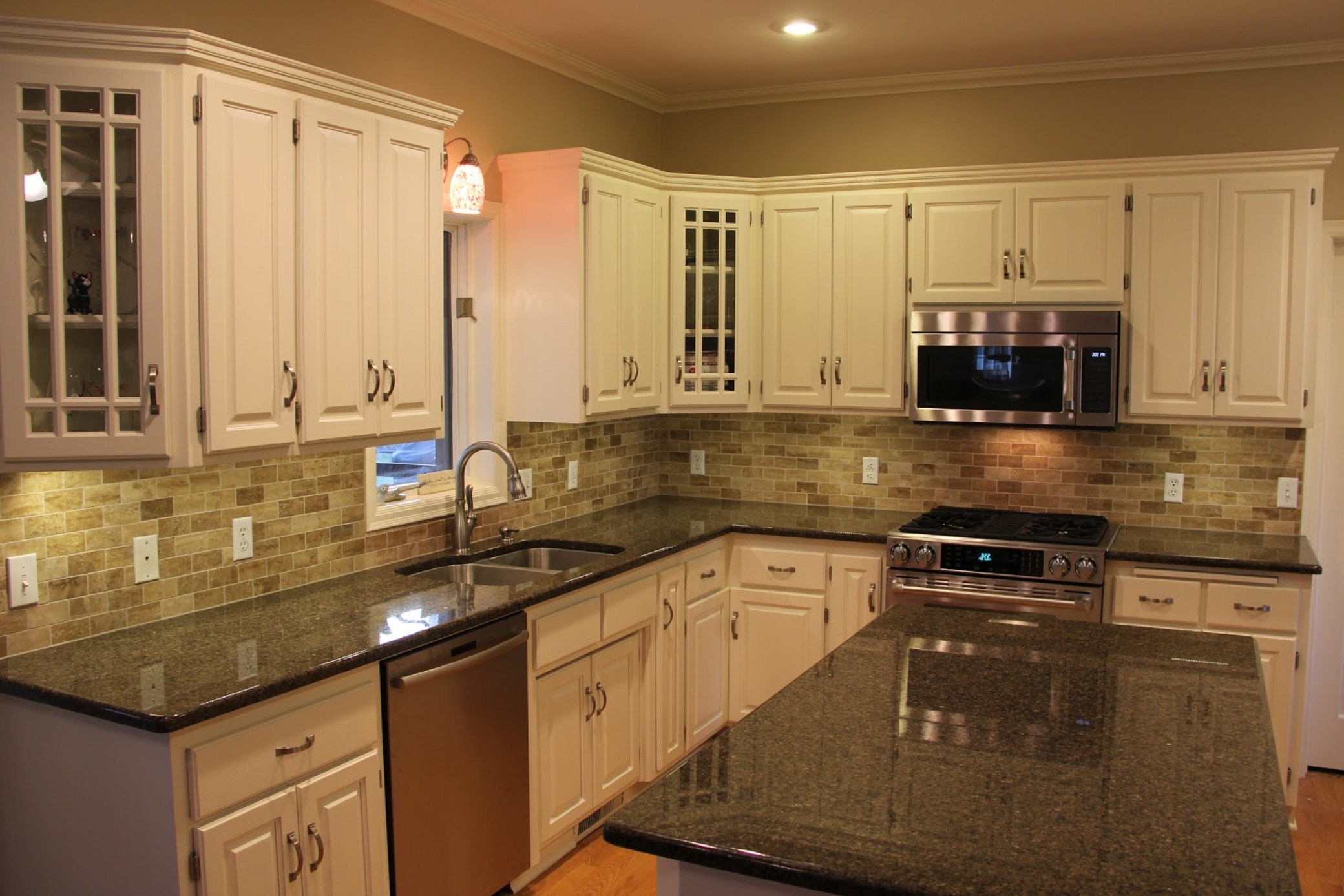 dark cabinets white backsplash photo - 7