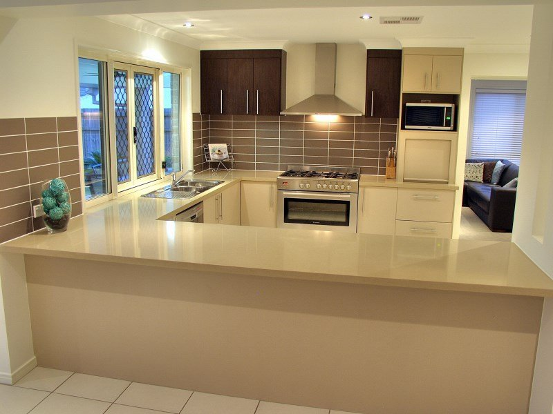 l shaped apartment kitchen photo - 10