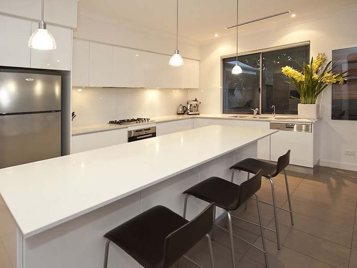l shaped apartment kitchen photo - 9