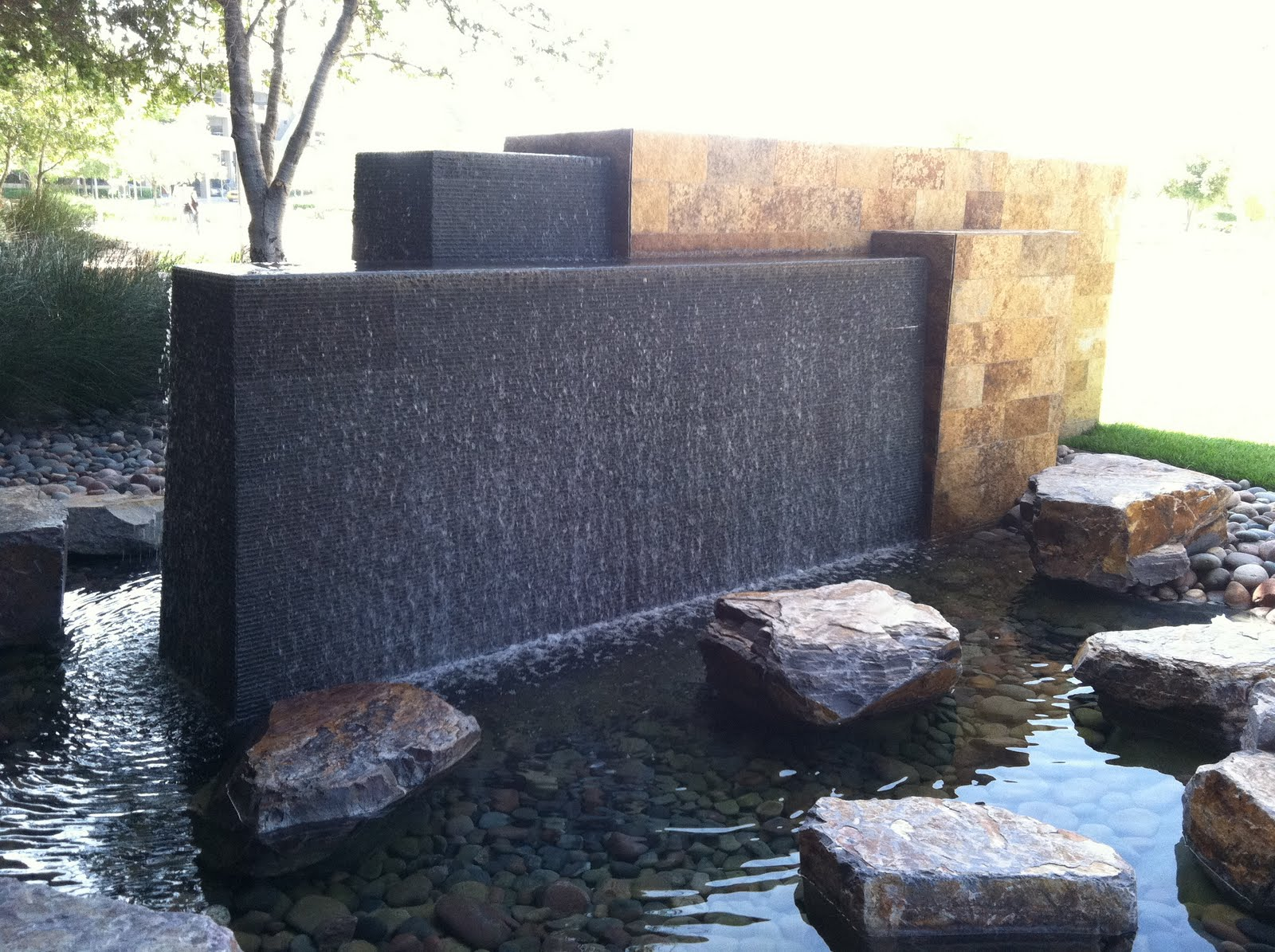 modern water fountains outdoor photo - 1