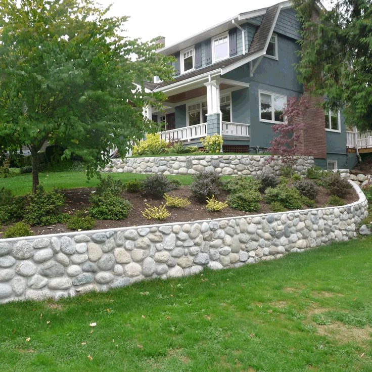 river rock garden wall photo - 1