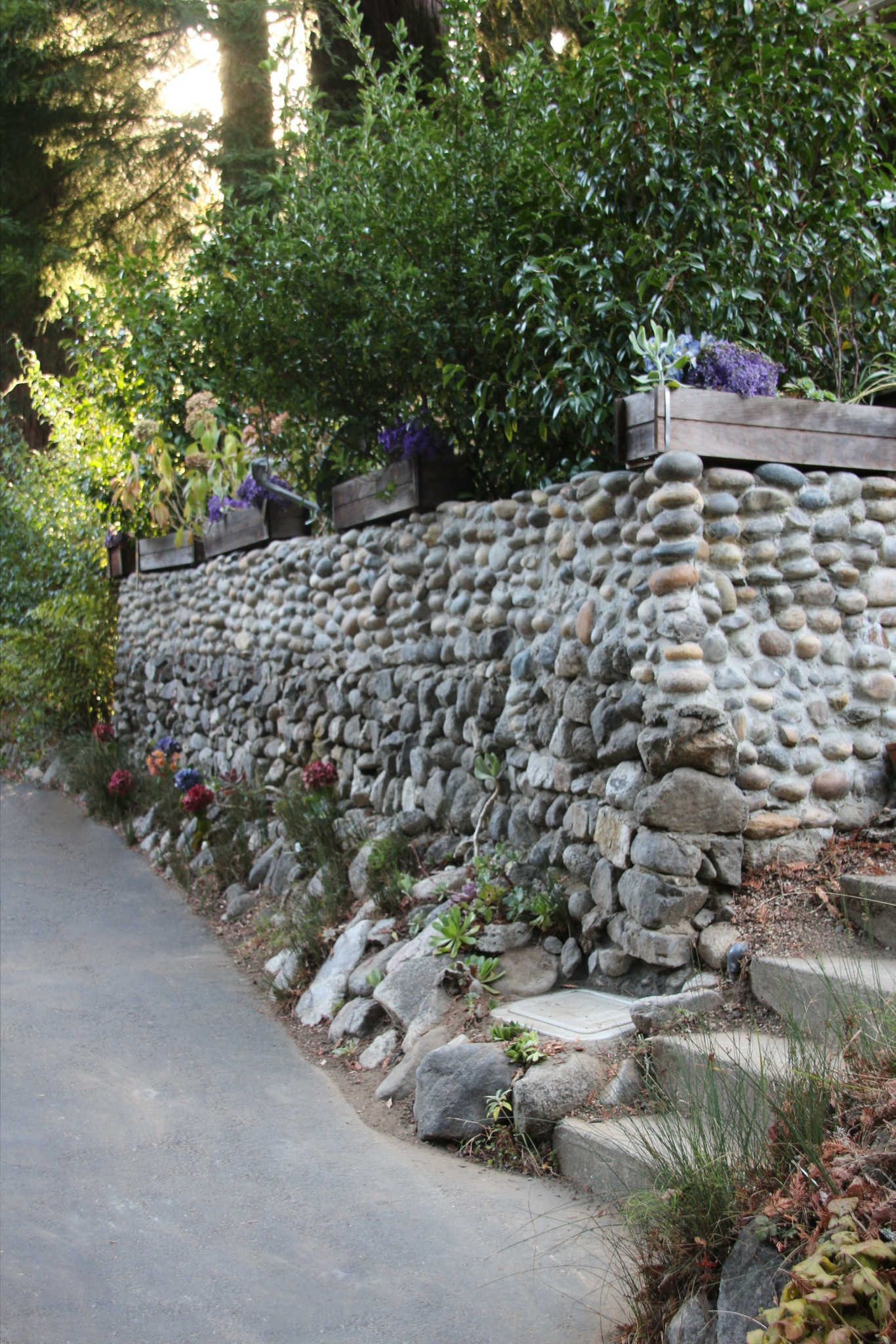river rock garden wall photo - 8