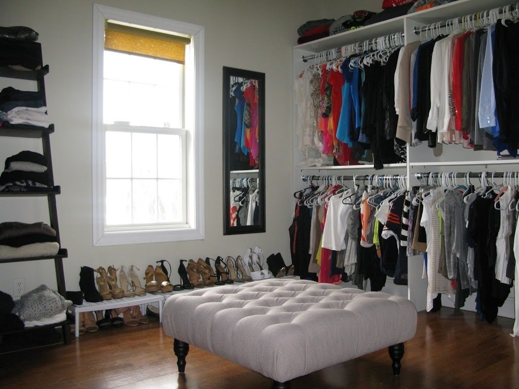 walk in closet in a small bedroom photo - 10