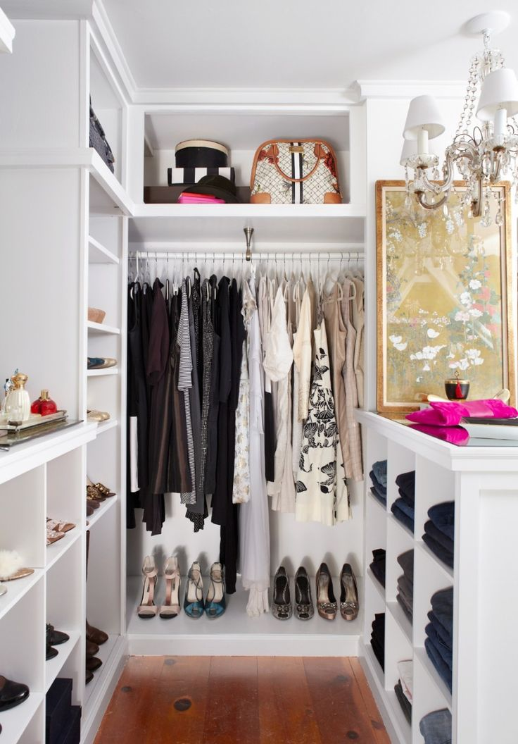 walk in closet in a small bedroom photo - 2