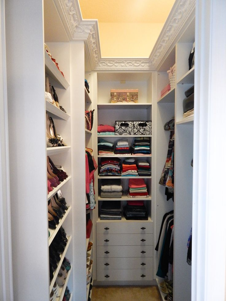 walk in closet in a small bedroom photo - 3