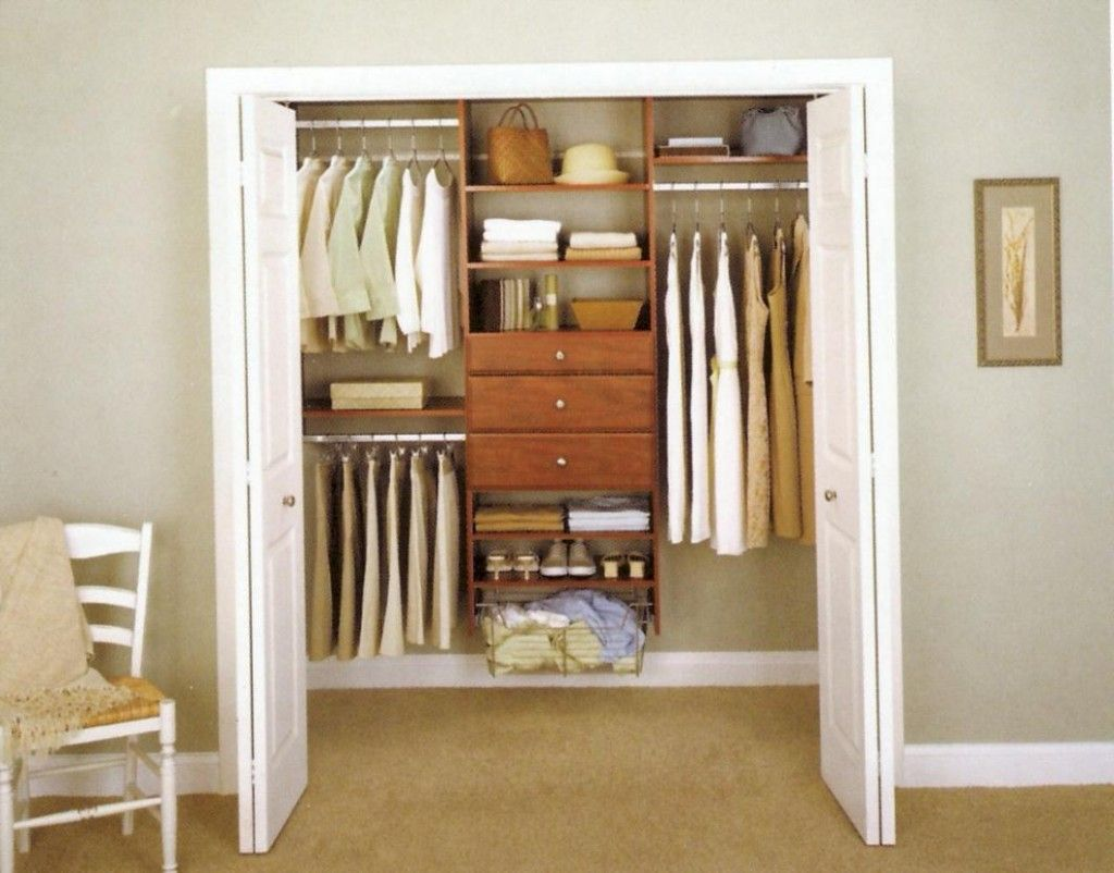 walk in closet in a small bedroom photo - 8